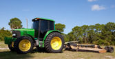 Green Tractor with brush cutter — Stock Photo
