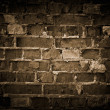 Royalty-Free Stock Photo: Rough brick wall, toned.