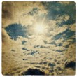 Sun on blue sky, vintage background. — Stock Photo