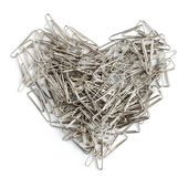 Stationery love concept. Heart shaped staples background. — Stock Photo