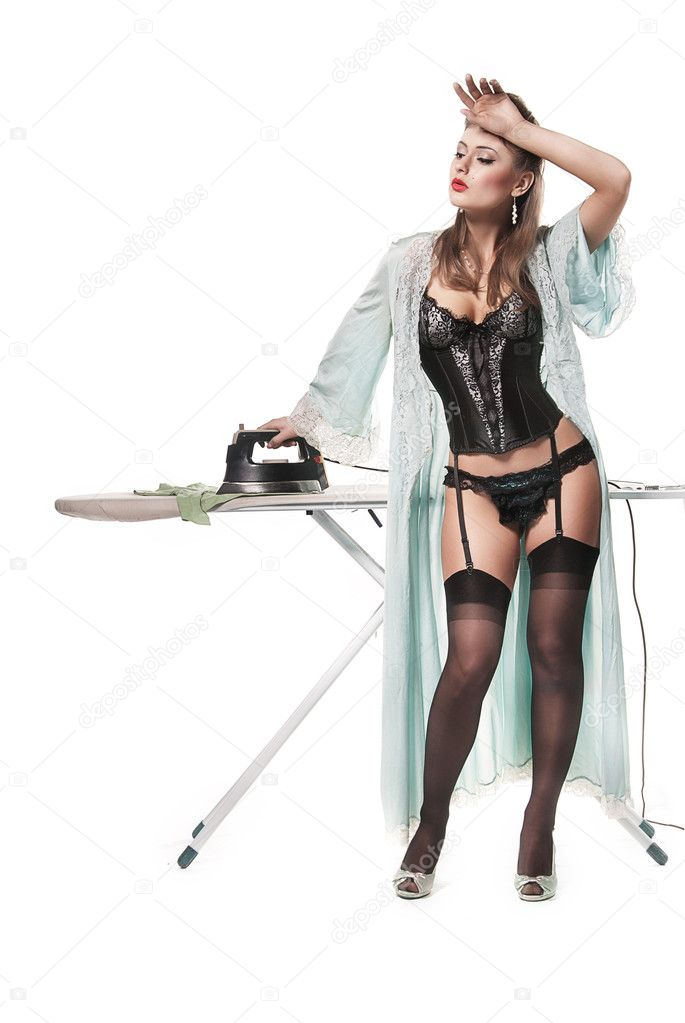 Ironing the kinky clothes while completely naked 2