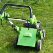 Lawn mower on fresh cut grass — Stock Photo