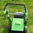 Lawn mower on fresh cut grass — Stock Photo