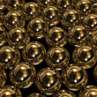 Stock Photo: Huge gold spheres
