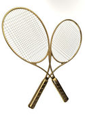 Gold tennis rackets. — Stock Photo
