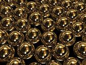 Huge gold spheres — Stock Photo