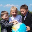 Friends with earth globe — Stock Photo