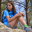 Stock Photo: Preteen Girl Sitting Outdoors