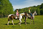 Girls Riding Horses — Stock Photo