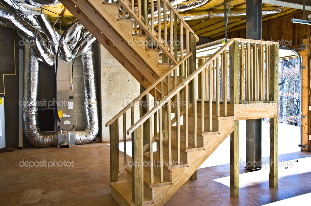 basement and garage interior steps and duct work stock photo