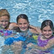 Three Cute Girls in a Pool — Stock Photo #5730923