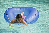 Young Girl on Tube in Pool — Stock Photo