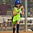 Young Girl Softball Player Running to First Base — Stock Photo #5859538