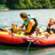 Family Fun Tubing on a Lake — Stock Photo