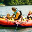 Family Fun Tubing on a Lake — Stock Photo #5859546