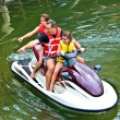 Man and Daughters on Jet Ski Pointing — Stock Photo #5885572