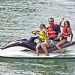 Man, Children and a Dog on Jet Ski - Stock Photo