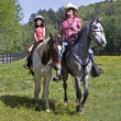 Girl and Woman Riding Horses - Stock Photo