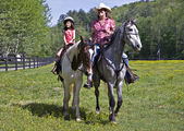 Girl and Woman Riding Horses — Stock Photo