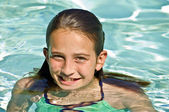 Preteen Girl in a Pool — Stock Photo