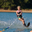 Young Girl Slalom Skiing - ストック写真
