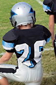 Young Football Player on Sidelines — Stock Photo