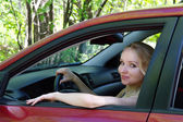 The girl the blonde in the red car in the summer, Moscow — Stock Photo