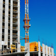 Building under construction with crane — Stock Photo