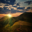 Peak of the hill with pathway and mountain sunset — Stock Photo