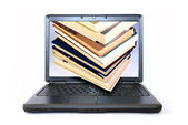 Books at monitor of laptop — Photo