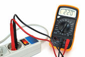 220v voltage on display of multimeter — Stock Photo