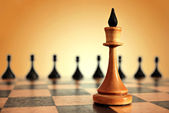 Chess king in focus and pawns — Stock Photo