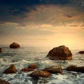 Sunrise on rocky sea coast — Stock Photo