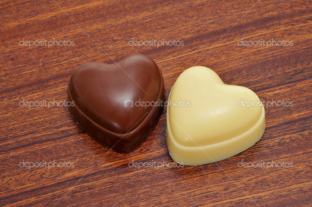 Closeup of two heart shaped chocolates — Stock Photo #5406427