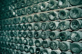 Spanish cava bottles in a wine cellar — Stock Photo