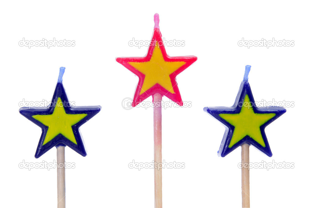 Three star-shaped candles on a white background — Lizenzfreies Foto #5649764