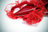 Red garter and pointy shoes — Stock Photo