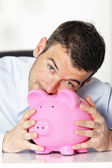 Kiss piggy bank — Stock Photo