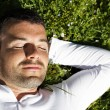Stock Photo: Sleeping in the grass