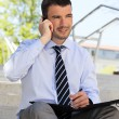 Businessman on the phone outdoor — Stock Photo