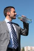 Businessman drink — Stock Photo