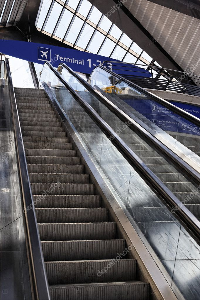 Escalator in France airport with terminal panel  Stock Photo #5895222