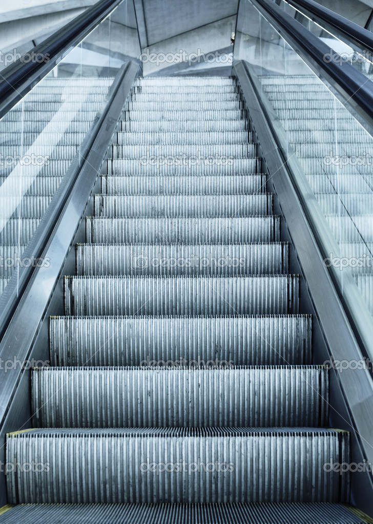 Escalator in France airport with terminal panel — Stock Photo #5895226