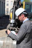 Hardhat on building site — Stock Photo