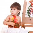 Funny child play with paints - Stock Photo