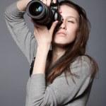 Beautiful woman photographer with camera — Stock Photo