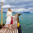 Woman walking on sea footbridge — Stock Photo