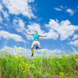 Stock Photo: Happy young man jump