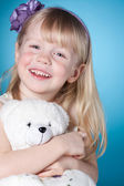 Happy smiling little girl with toy — Stock Photo