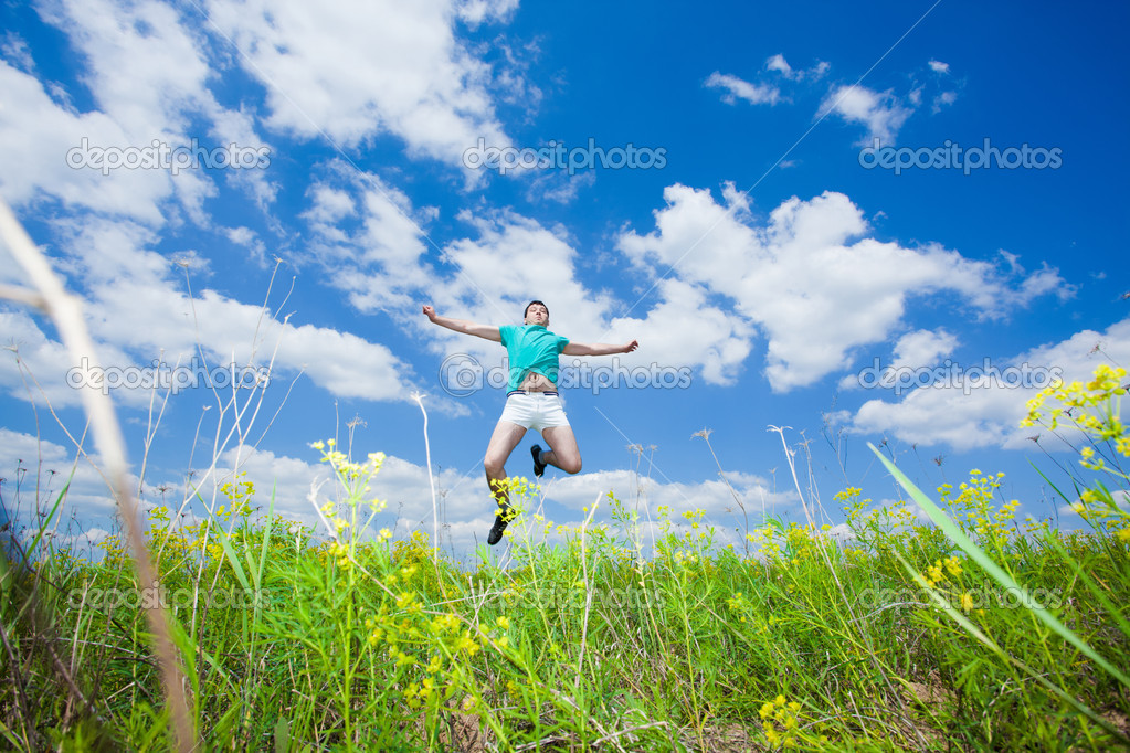 Happy young man jump on summer field — Stock Photo #5548318